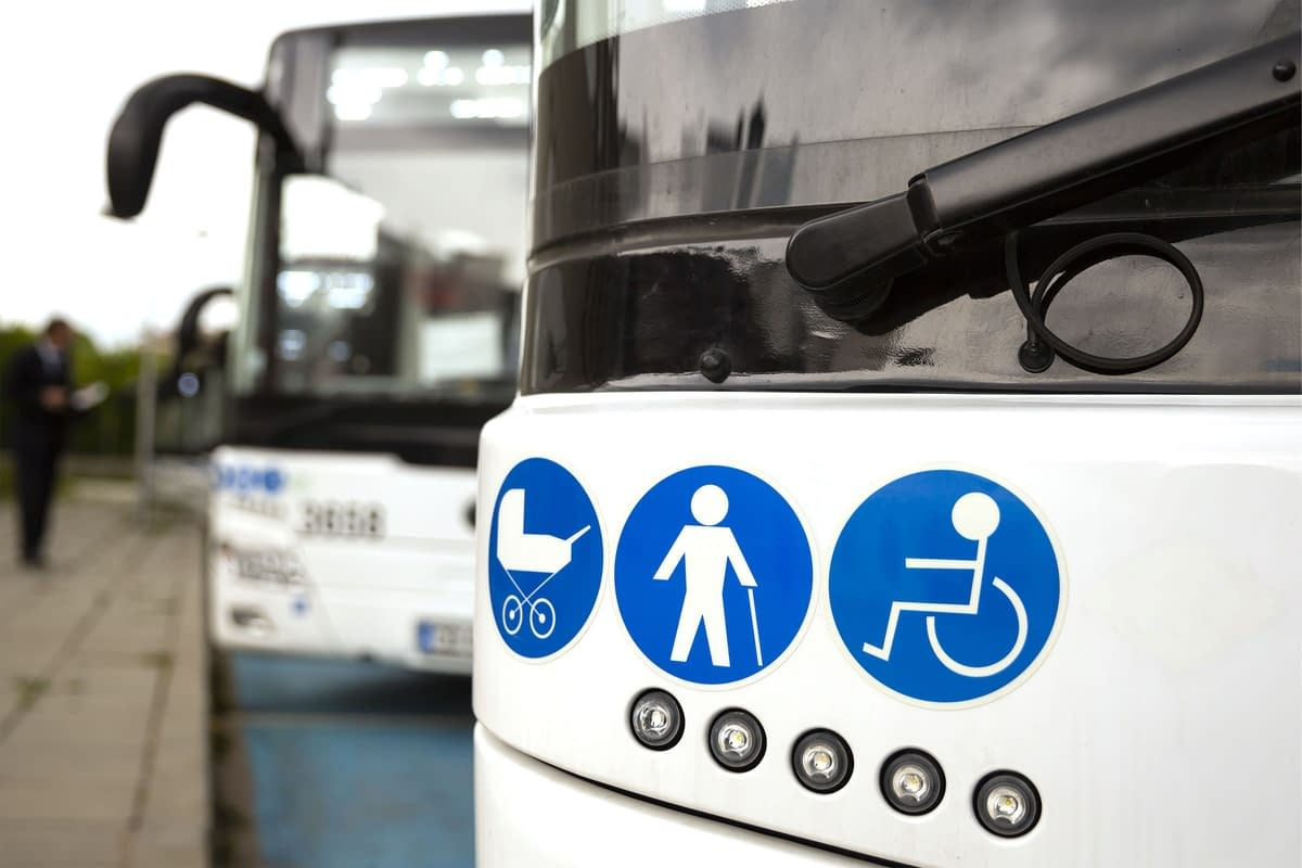 Close-up of a bus with stickers on the subject of accessibility
