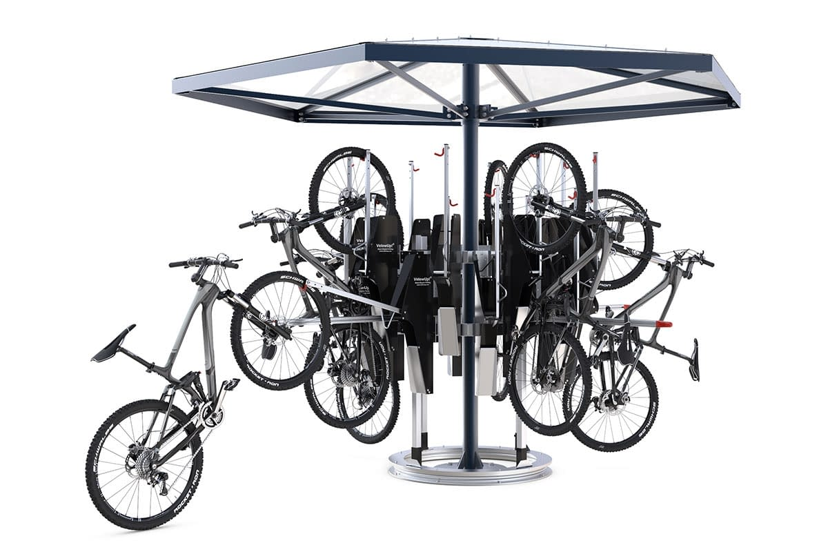 A bicycle carousel with adjusted bicycle wheels. A bicycle is being adjusted.