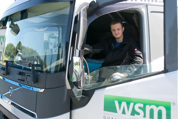 Trainee in a truck as a professional driver