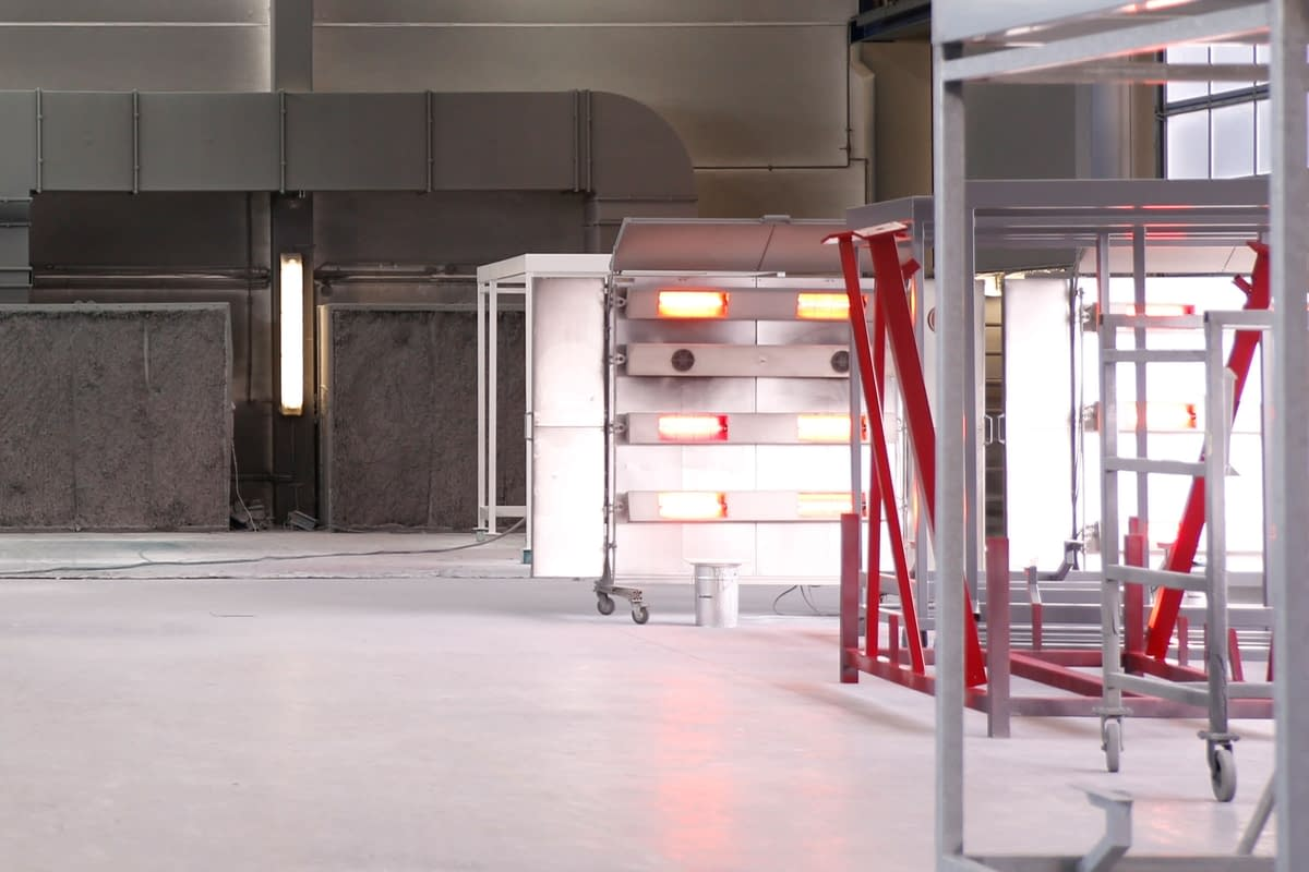 Interior view of the painting hall and the infrared drying lamps