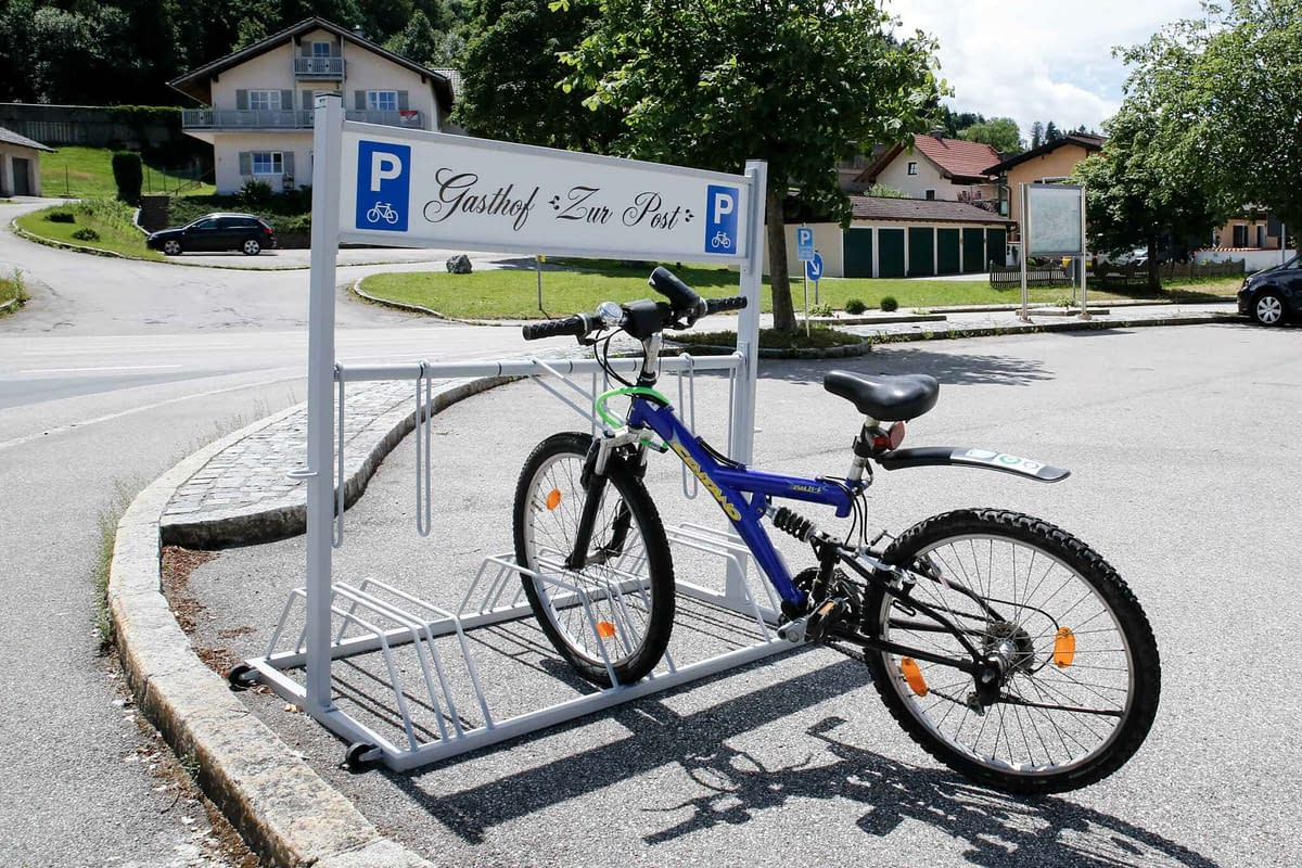 Advertising bicycle stand with parked bicycle