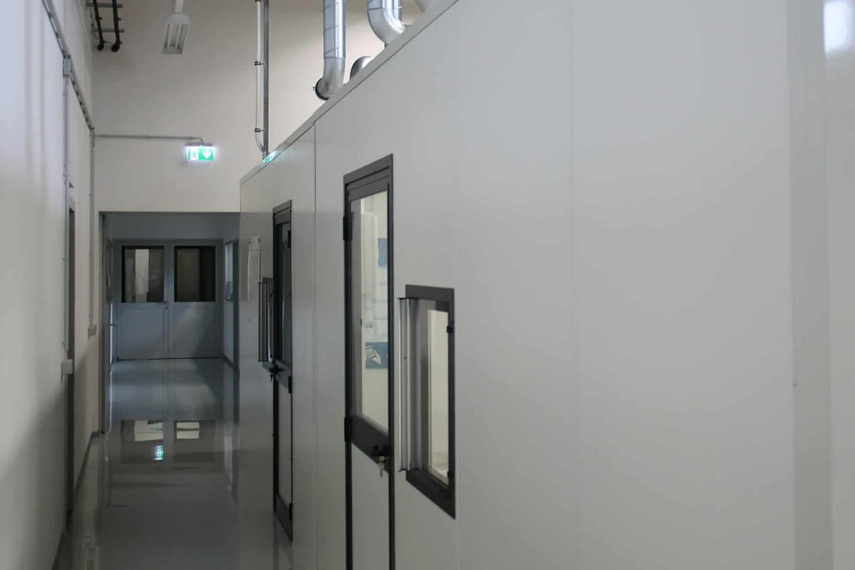 A partition wall seperates a big space into smaller compartments